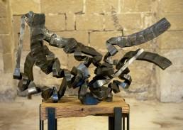 La expansión (2010) Hierro macizo. Peana de roble y hierro. 127 x 120 x 90 cm